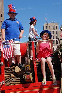 73a82d3b13c121df-wmaxwell-sennette-nadija-and-matija-mamula-ride-an-antique-fire-engine-in-the-parade1-200x300